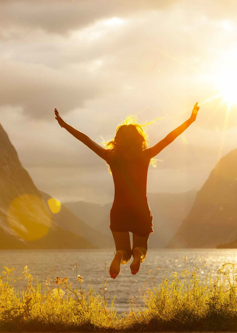 happy-woman-jumping-live-happily-secrets